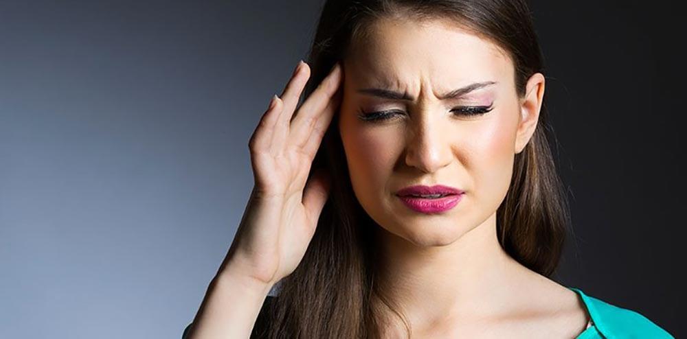 Mark Lovett Web Design lady with headache pic